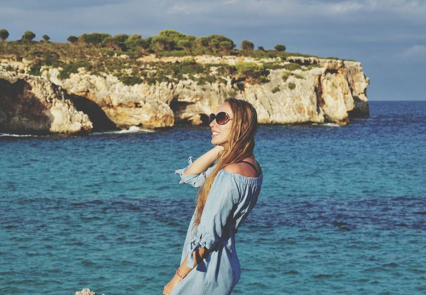 EyeEm Selectswoman on cala varques, mallorca, spain Sunglasses Sea Rock - Object Nature Beach Beautiful People Been There. Water Travel Destinations Mediterranean  SPAIN Majorca Mallorca Balearic Islands Cliff Woman Cala Varques Second Acts An Eye For Travel Love Yourself