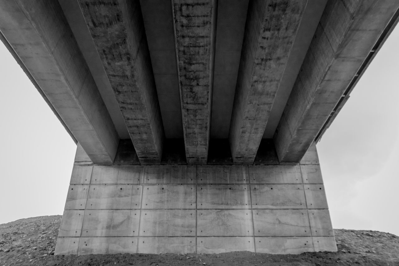 bridge - man made structure, connection, architecture, engineering, underneath, below, built structure, low angle view, transportation, architectural column, outdoors, bridge, day, no people, under, sky