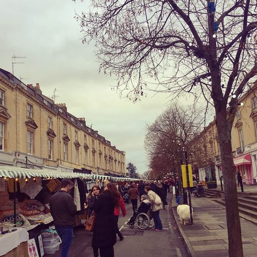 Cheltenham Christmas Market in Montpellier Street Adult Architecture Building Exterior Builings Built Structure Cheltenham Christmas Market City Day Land Vehicle Large Group Of People Men Montpellier Outdoors People Real People Sky Street View Tradition Tree Tree Women