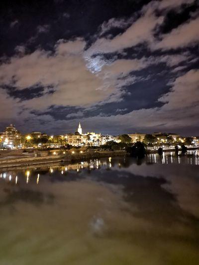 On Sale Sevilla Spain Triana Bridge Giralda Guadalquivir Triana, Sevilla 17.62° Cityscape City Sea Water Beach Astronomy Star - Space Sunset Politics And Government Sky Horizon Over Water Calm Moored
