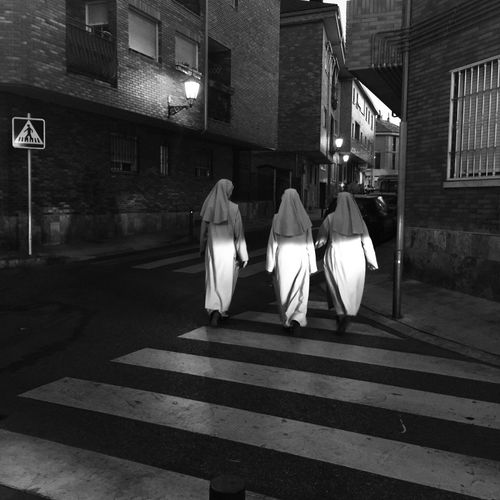 Sisters (At Night). Street Black&white Photography Composition Eye4photography  B&w Photooftheday Fine Art Photography Blackandwhite Monochrome IPhoneography Photography Is My Escape From Reality! Streetphotography Shootermag Streetphoto_bw Creativity Outdoors Showcase: September Black And White Art Moments Enjoying Life Feel The Journey The Street Photographer The Street Photographer - 2017 EyeEm Awards