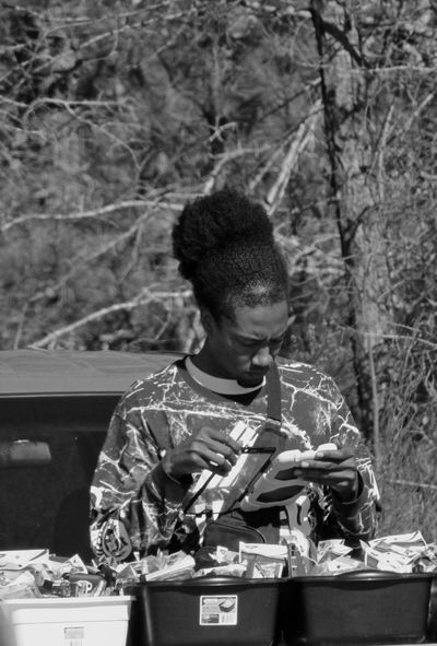 Flea market seller Brown Canon Canonphotography Composition Front View Happiness Holding Leisure Activity Lifestyles Looking Occupation Part Of Perspective Portrait Real People Relaxation Streetphoto_bw Streetphotography Young Men