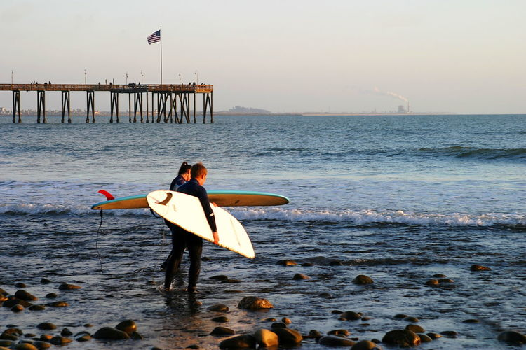 Off To Sunset Surf Surfer at sunset at the beach near the pier in Ventura California. Active Beach Blue California City Extreme Fun Ocean Pier Ride Sea Shore Sport Summer Sunset Surf Surfboard Surfer Surfing Ventura Water Wave Waves Wet Wetsuit
