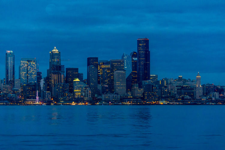 Seattle city lights. Building Exterior Architecture Built Structure Building City Waterfront Water Sky Office Building Exterior Cityscape Skyscraper Illuminated Urban Skyline Landscape Dusk Blue Sea Tall - High Nature No People Modern Outdoors Financial District  Night Lights