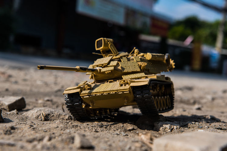 Close-up of toy army vehicle on land