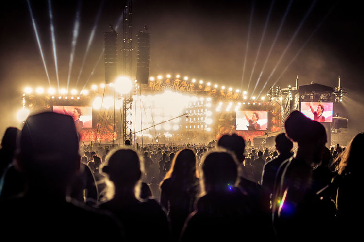 Group Of People Crowd Large Group Of People Illuminated Real People Arts Culture And Entertainment Enjoyment Night Men Lighting Equipment Audience Event Performance Stage Stage - Performance Space Music Fun Women Adult Light Festival Stage Light Music Festival Popular Music Concert Nightlife