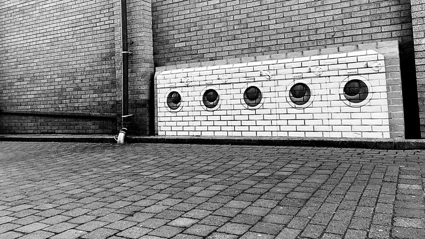 Building Exterior Washing Machines Empty Street Black & White Black And White Noir Urban Urban Geometry Circles Stones