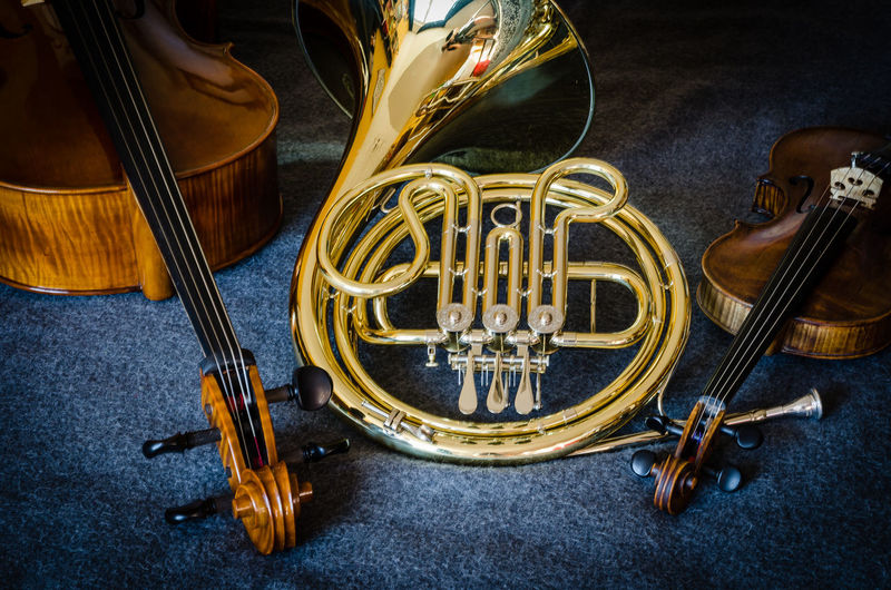 High angle view of various musical instruments on table