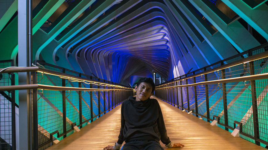 Portrait of man standing on footbridge