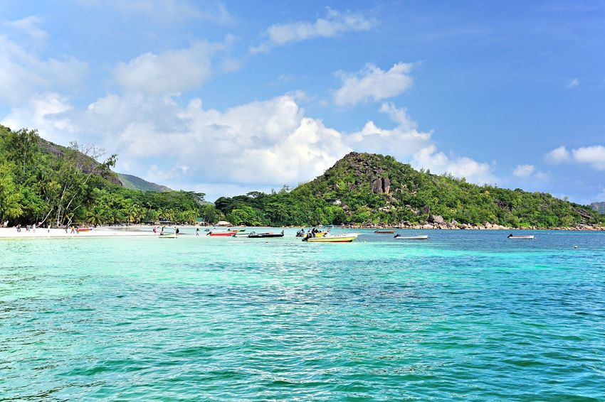 Beach Anse Volbert on Praslin, Seychelles, seen from the sea Bay Beach Blue Day Destination Exotic Island Landscape Luxurous Mountain Nature Ocean Outdoors Paradise Romantic Scenic Scenics Sea Sky Solitude Tranquil Scene Tranquility Travel Tropical Water