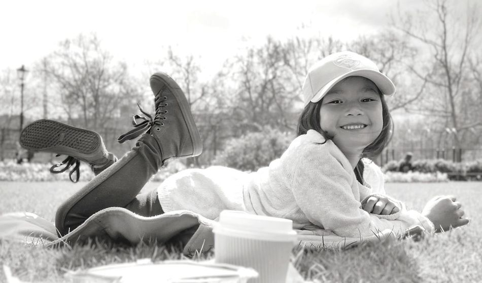 Sunny park day Looking At Camera Portrait Outdoors Happiness Cheerful At The Park Lying On Grass Black & White Black And White Photography Sunny Day Grass Hyde Park London Photography Smiles Smiling Face Children At The Park Child Smiling Potrait Of A Child Black And White Friday Be. Ready. Black And White Friday This Is Family