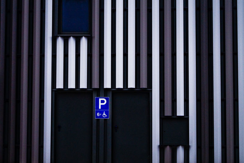 Disabled parking sign on wall