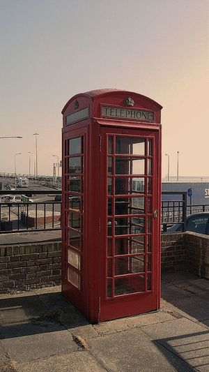 View of telephone booth against sky