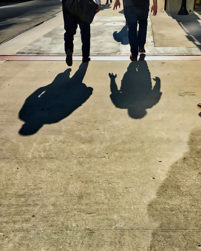 Shadows of two businessmen walking on city street. Waysofseeing Chicago Commuter Footpath Hands Sidewalk Body Part City Day Human Body Part Human Foot Human Leg Human Limb Leisure Activity Lifestyles Low Section Men Nature Outdoors People Real People Shadow Street Sunlight Togetherness Walking The Street Photographer - 2018 EyeEm Awards
