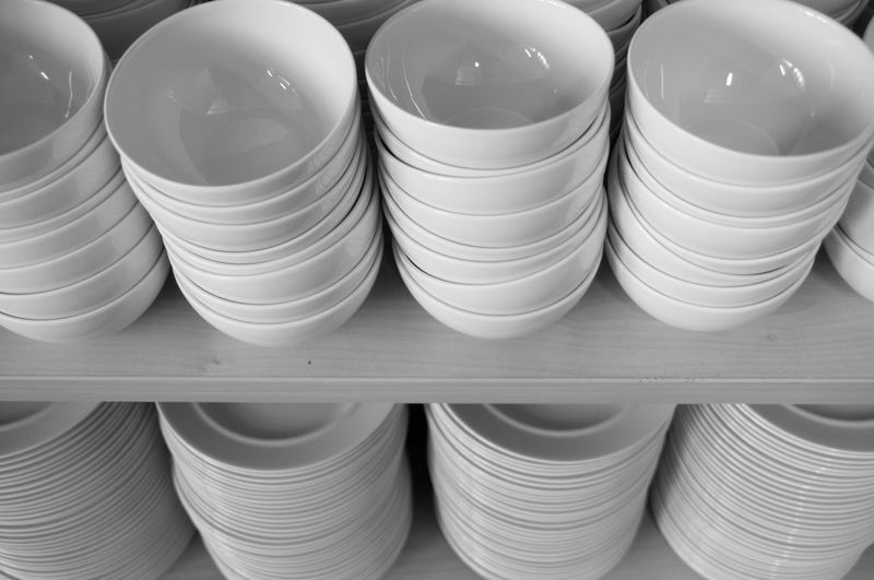 High angle view of bowls and plates stacks at store