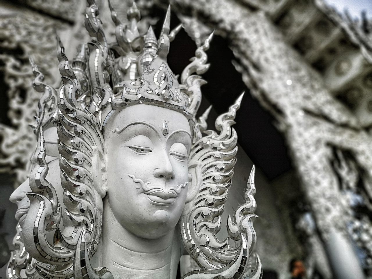 sculpture, human representation, art and craft, statue, representation, religion, belief, spirituality, creativity, male likeness, close-up, focus on foreground, architecture, no people, built structure, place of worship, female likeness, building, craft, day, ornate, idol