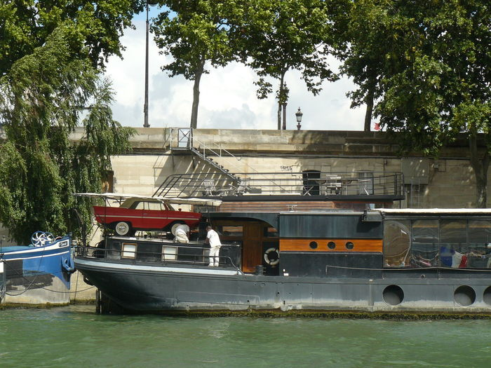 Paris Architecture Building Exterior Built Structure Day Mode Of Transportation Moored Nature Nautical Vessel No People Outdoors Passenger Craft Plant Public Transportation River River Sena Sky Transportation Travel Tree Water Waterfront