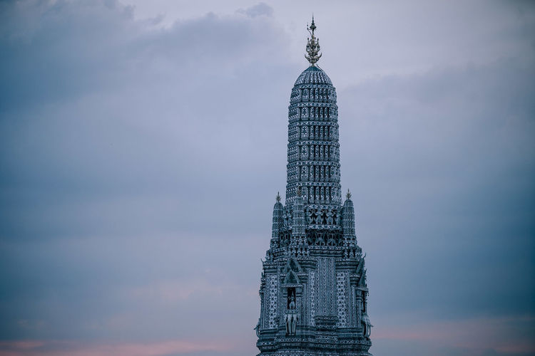 Temple of Dawn Wat Arun on Chao Phraya River, Wat Arun top of the dome against a dusk skies. ASIA Ancient Architecture Arun Asian  Bangkok Beautiful City Construction Famous Place Skies Top Art Color Decorated Dome Dusk History Landmark Religion Religious  Sculpture Sky Temple - Building