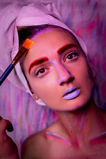 Portrait of woman applying make-up