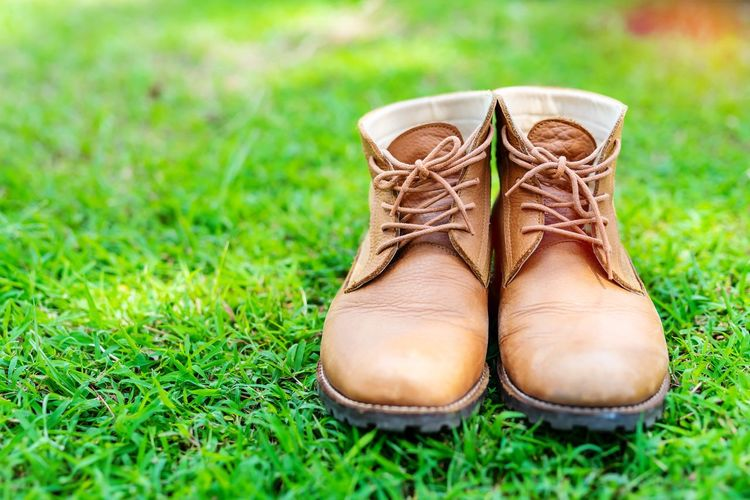 Close-up of shoes on grass