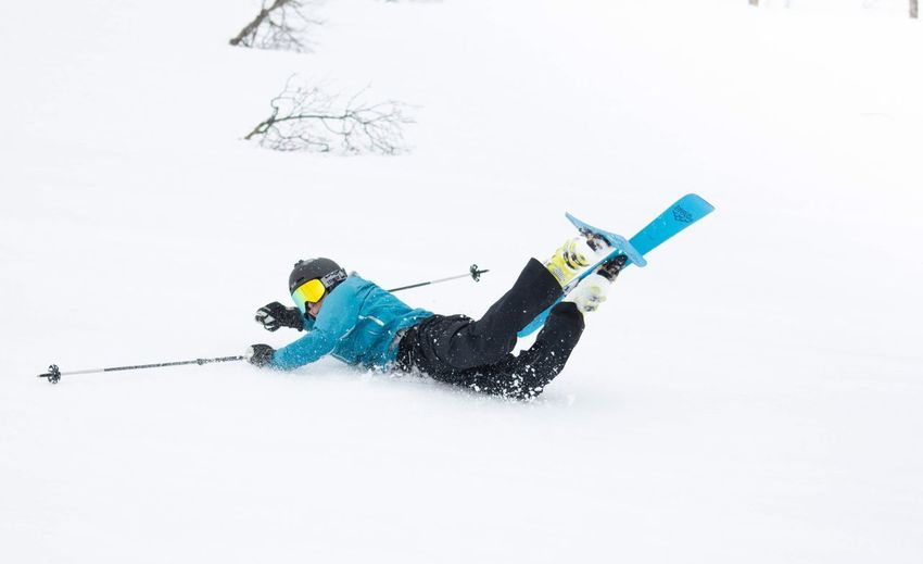 Person skiing on snow on land