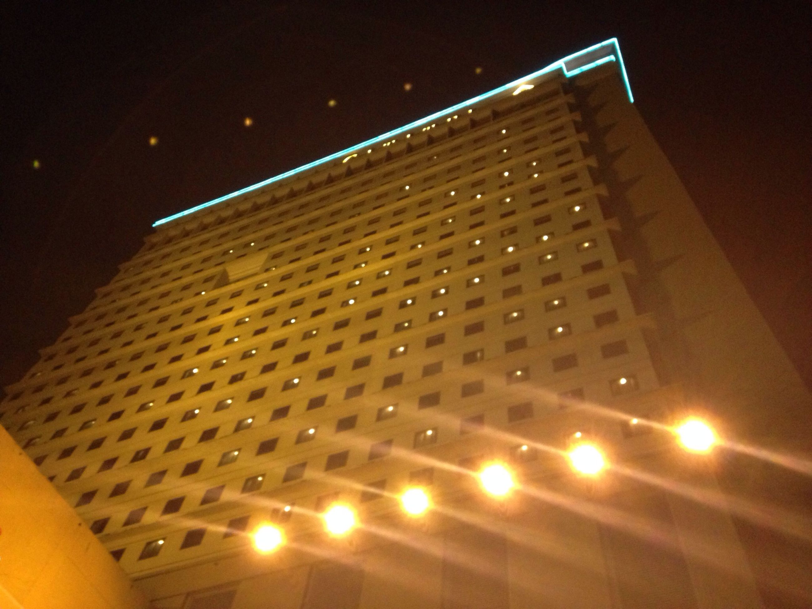 low angle view, illuminated, architecture, built structure, night, building exterior, modern, pattern, lighting equipment, indoors, building, no people, sky, light - natural phenomenon, glowing, city, tall - high, sunlight, skyscraper