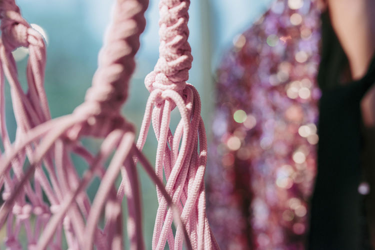 Close-up of pink decoration hanging outdoors