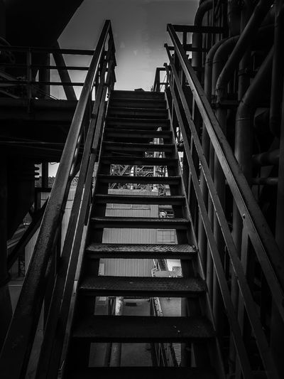 Stairs - Landschaftspark Duisburg Height Tourism Abandoned Buildings Abandoned Places Landschaftspark Duisburg-nord Duisburg Landschaftspark Copy Space Sightseeing Spot Centered Perspective In Front Centered City Marketing Marketing Black Blackandwhite Photography Black & White Girder Steel Steps And Staircases Staircase Architecture Built Structure Sky Building Exterior Steps Stairway Railing Bannister Hand Rail #urbanana: The Urban Playground