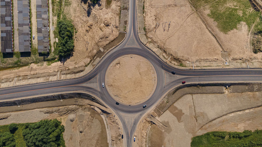 Top down aerial view of a new traffic roundabout. solving problem of jams. construction business.