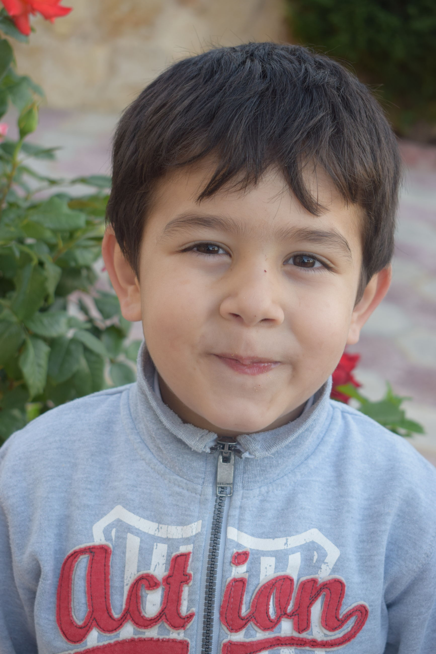 portrait, child, one person, real people, males, boys, childhood, men, front view, headshot, looking at camera, casual clothing, innocence, focus on foreground, cute, close-up, lifestyles, day, making a face
