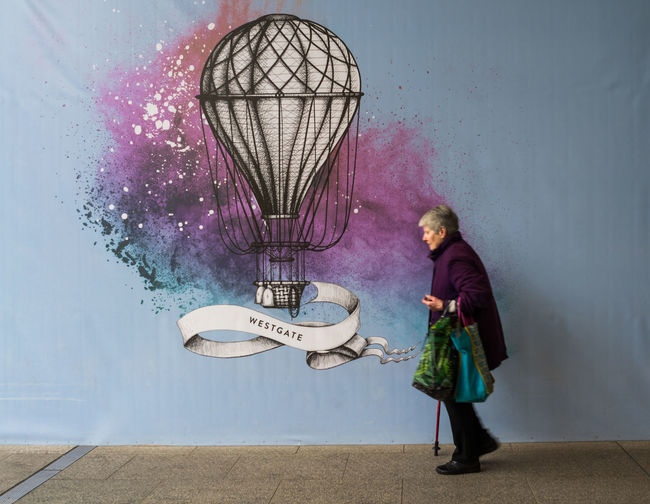 take me away.... Streetphotography Streetart Streetphoto_color Street Photography Urban Geometry City Life Citystreets Multicolored Urban Mural Art Full Length Standing Hot Air Balloon Energetic Flying Ballooning Festival This Is Aging This Is Family Visual Creativity The Street Photographer - 2018 EyeEm Awards The Still Life Photographer - 2018 EyeEm Awards #urbanana: The Urban Playground International Women's Day 2019 British Culture