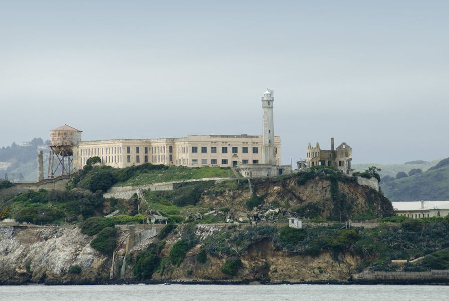 The famous Alcatraz Island prison in San Francisco Bay, which housed Al 'Scarface' Capone. Alcatraz America Architecture Bay Building Built Structure California Coastline DISUSED Escape Famous Famous Place Façade Historic Historical History Island Isolation Jail Landmark Landscape Lighthouse Old Penitentiary Travel Destinations