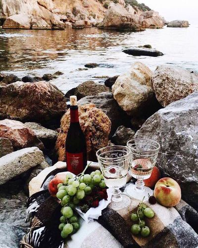 Lovely time 😍😍💞♥️💓 Bottle Fruit Food And Drink Still Life Rock - Object High Angle View Wine Bottle Wine Healthy Eating Beach Drink Drinking Glass Outdoors Alcohol Wineglass First Eyeem Photo Freshness Style Relaxing Chilling