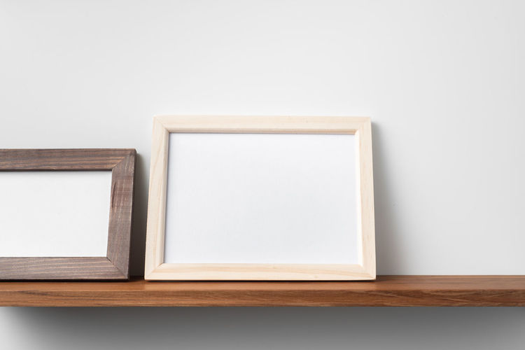 Close-up of empty table against white background