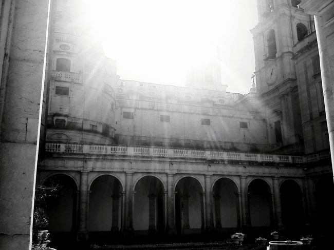 Architecture Arch Built Structure Lens Flare Sunlight No People Low Angle View Outdoors Building Exterior Day Sky Convento De Mafra Conventomafra📖📓📔📒📙📘📗📕📚 Mafra Mafra, Portugal Monastery Monastry Blackandwhite Black And White Black & White Blackandwhite Photography Black&white Black And White Photography
