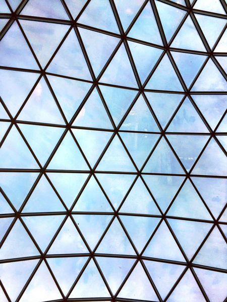 A glass ceiling made up of interlocking triangle shapes. Design Modern Roof Ceiling Triangular Triangle Glass Pattern Full Frame Backgrounds No People Shape Design Close-up Grid Geometric Shape Indoors  Architecture