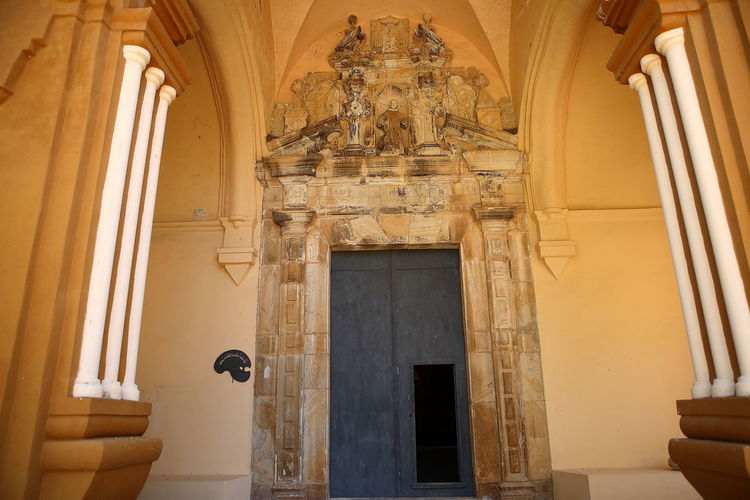 Low angle view of ornate door in building