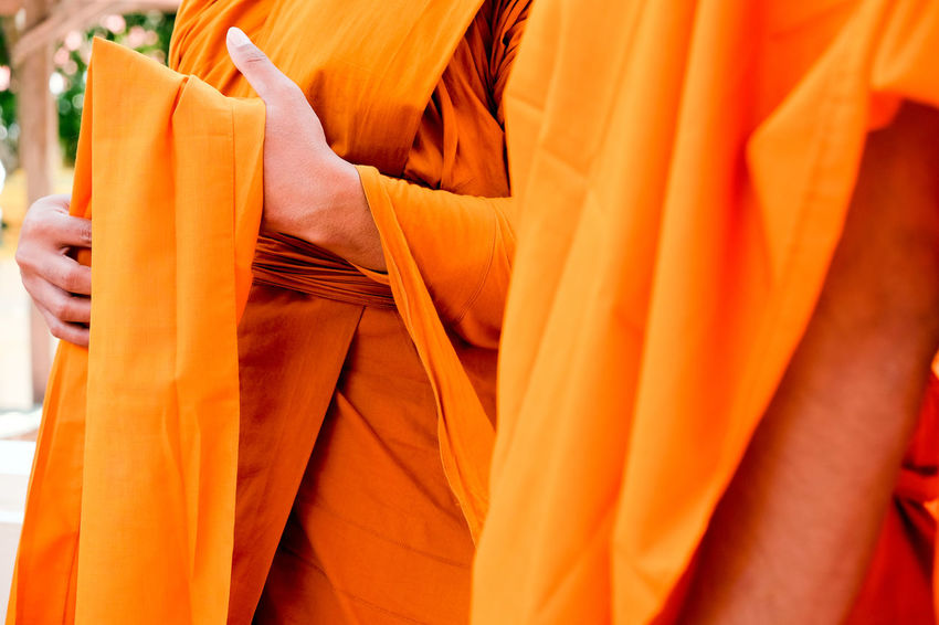 Yellow robe of Buddhist monks, Closeup on buddhist monk Buddhist Buddhist Temple In Thailand Religion And Tradition Religious Art Buddhist Culture Buddhist Monks Buddhist Temple Close-up Clothing Hand Human Body Part Human Hand Lifestyles Midsection Monk  Monks Orange Color People Real People Religion Religion And Beliefs Religious  Robe Textile Yellow Robe
