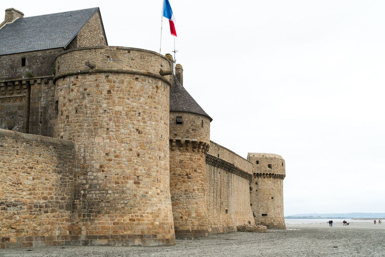 View of historical building against sky. walls of the mount saint michel