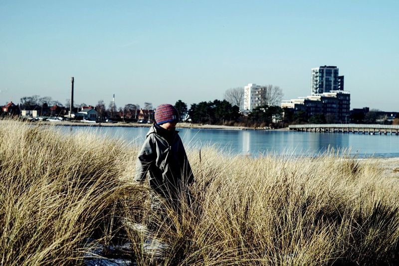 Kid Wanderlust Wander Wandering Landscape Outdoors Nature Water Reflections Water Waterfront Clear Sky Grassland Grass Grass One Person Architecture Sky Lifestyles