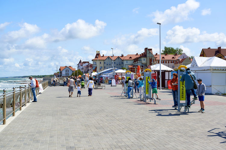 Zelenograd, Russia - July 16, 2016: People walking along the seafront promenade. Curonian spit, Kaliningrad region. Russia Baltic Sea City Coast Curonian Spit Editorial  Kaliningrad Outdoors Path Pathway Pedestrians People Promenade Quay Russia Seafront Seaside Sidewalk Summer Summertime Sunny Day Tourists Urban Walkway Waterfront Zelenograd