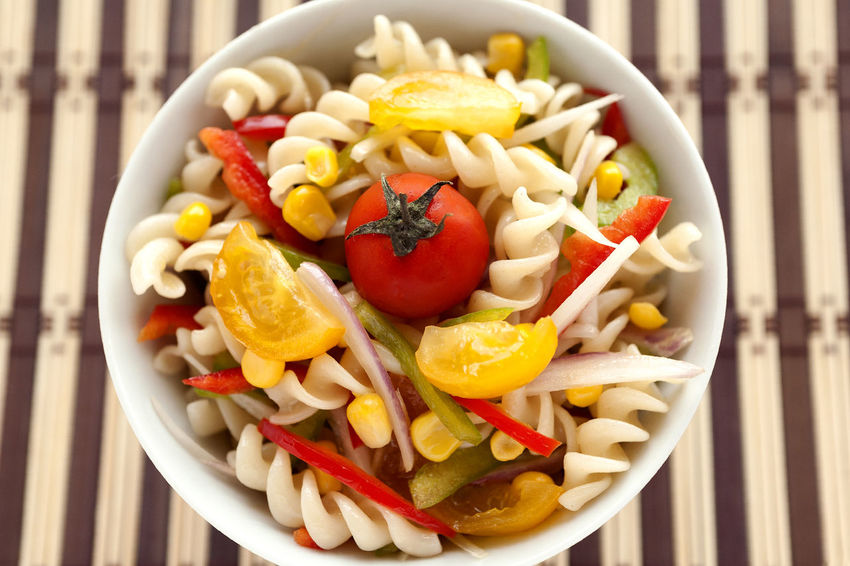 Fusilli salad with yellow and red cherry tomatoes, red and green pepper, sliced onion and corn grains bowl. Top View. Fusilli Natural Light Salad Spanish Onion Bowl Cherry Tomatoes Corn Grain Directly Above Food Food And Drink Freshness Fusilli Pasta Fusilli Salad Green Peppers Healthy Eating No People Pasta Salad Ready-to-eat Red Peppers Striped Background Studio Photography Summer Salad Tomato Vegetable Yellow Cherry Tomato