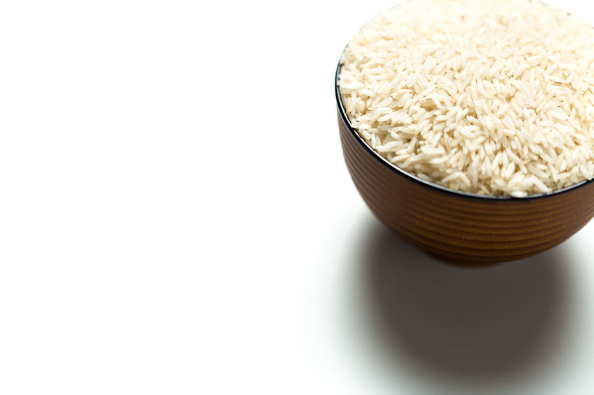 A rice in a bowl isolated over white background. ASIA Basic Bowl Business Calories Carbohydrates Cooking Culture Daily Dish EyeEmNewHere Food Glucose Grain Health Healthy Eating Hungry Isolated Organic Protein Restaurant Rice Sugar Traditional Uncooked