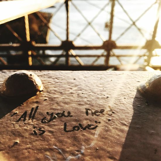 Text Close-up Sunlight Communication No People Day Outdoors Brooklyn Bridge / New York Love Is All You Need Love