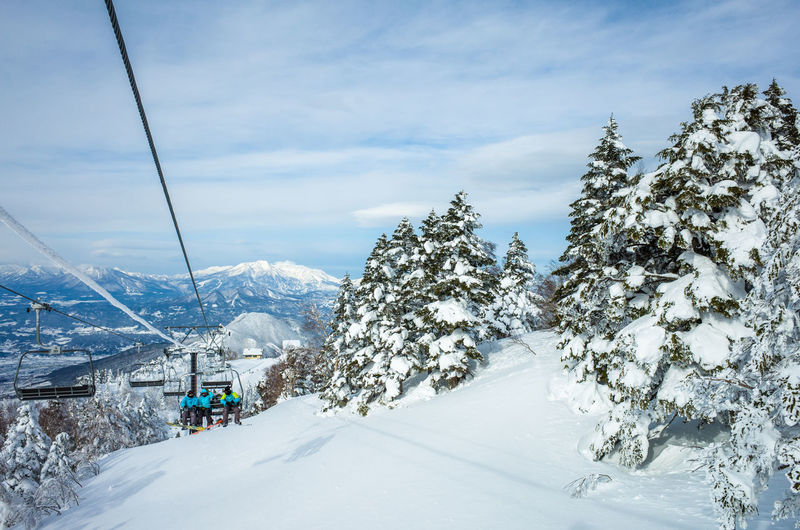 The best thing since sliced bread Winter Snow Cold Temperature Tree Scenics - Nature Mountain Beauty In Nature Day Nature Sky Mountain Range Cloud - Sky White Color Tranquil Scene Cable Car Landscape Snowcapped Mountain No People Outdoors Ski Resort  Extreme Weather Coniferous Tree Pine Tree Winter In Japan Snowboarding