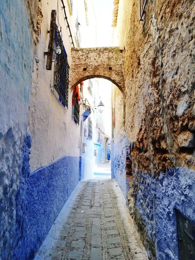 long walk way in chefchaoune, Morocco Blue Bluecity Chefchaoune Morocco Africa Soonjourney MyWanderLust Day Arch Walkway Architecture Built Structure Narrow Arched Long Alley Wall