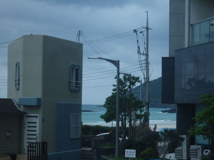 Ocean View Architecture Building Exterior Built Structure City Day Electricity Pylon No People Ocean Outdoors Sky Tree