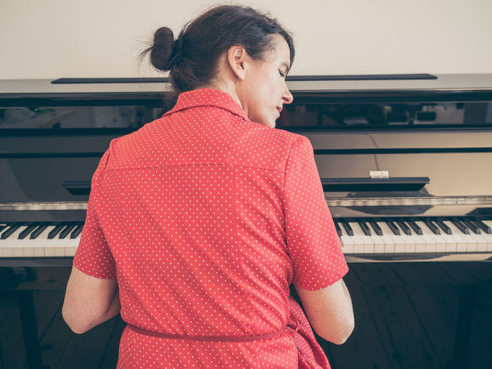 Woman Playing The Piano