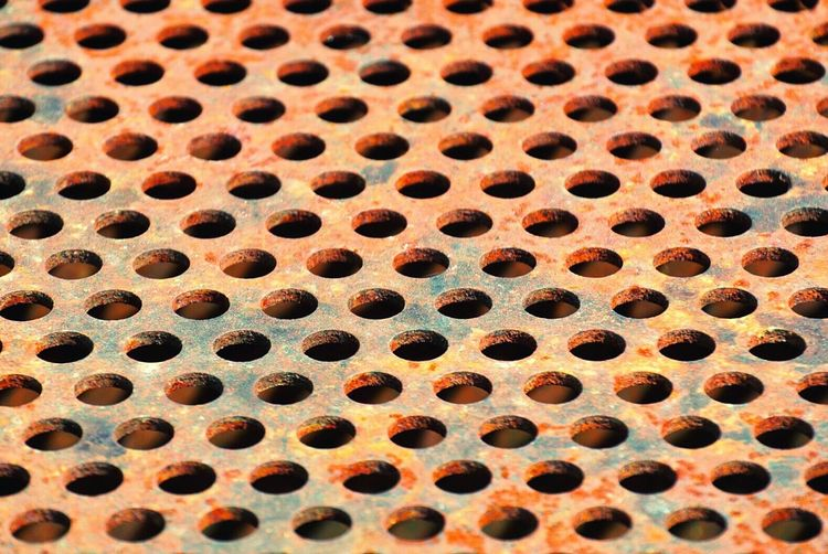 Built Structure Pattern, Texture, Shape And Form Backgrounds Structure Day Textures And Surfaces Surface Full Frame Pattern Dots Rust Rusty Steel Hole Metal Close-up No People Weathered Repetition Brushed Metal Run-down Deterioration Iron Bad Condition Circle Shape In A Row Geometric Shape Textured  Design