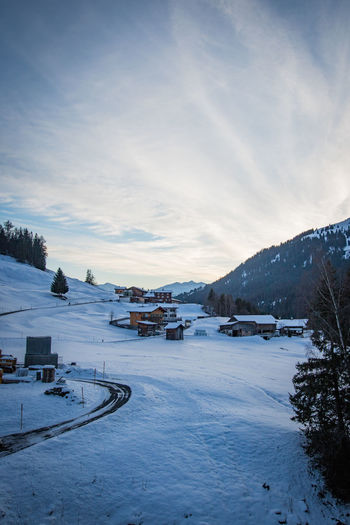 st. antönien in the evening Graubünden St. Antönien Alps Architecture Beauty In Nature Built Structure Cloud - Sky Cold Temperature Day Evening Frozen Landscape Mountain Nature No People Outdoors Scenics Sky Snow Tranquil Scene Tranquility Transportation Tree Weather Winter Shades Of Winter